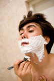 Man shaving Royalty Free Stock Photography