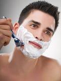Man shaving Stock Images