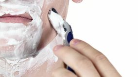 Man shaving as part of his morning routine. Change focus stock video footage
