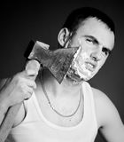 Man shaving with ax Royalty Free Stock Photo