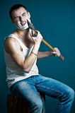 Man shaving with ax Royalty Free Stock Images