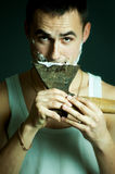 Man shaving with ax Stock Photos