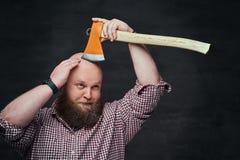 A man shaving with an axe. Stock Photo