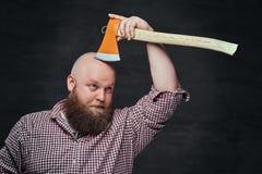 A man shaving with an axe. Stock Photos