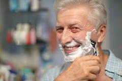 Man shaving in bath Stock Photo