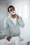 Man shaving in the bathroom. At home Stock Photography