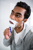 Man shaving in the bathroom. At home Royalty Free Stock Image