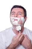 Man shaving beard Stock Image