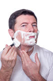 Man shaving beard Royalty Free Stock Photography