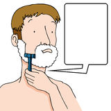 Man Shaving Beard. An image of a man using a razor to shave his face Royalty Free Stock Photo