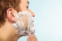 Man shaving beard face profile Royalty Free Stock Photo