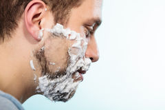 Man shaving beard face profile Stock Photo