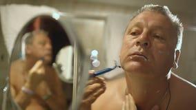 Man shaving stock video footage