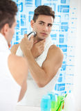 Man shaving with electric shaver Stock Image
