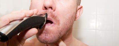 Man Shaving Face Stock Photo