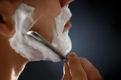 A man shaving face. Close-up of a man shaving Stock Photo