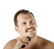 Man shaving face with electric razor Stock Photo