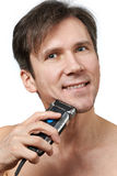 Man shaving face with electric razor Royalty Free Stock Photo