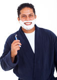 Man shaving face Royalty Free Stock Images