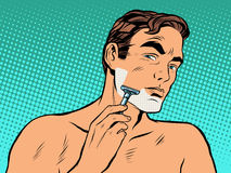 Man shaving foam. Pop art retro style. Personal hygiene. A man shaves in the morning stubble on his face vector illustration