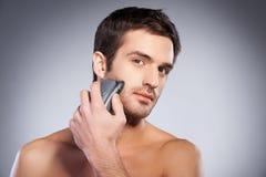 Man shaving. Royalty Free Stock Image