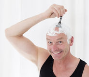 Man shaving head Royalty Free Stock Images
