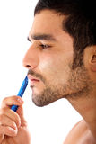 Man shaving his beard Stock Images