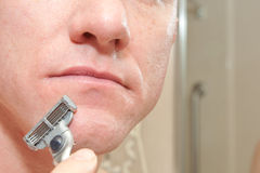 Man Shaving Stock Image