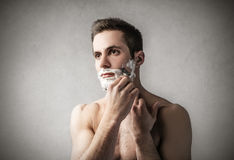 Man shaving his face Royalty Free Stock Image