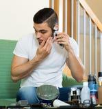 Man shaving his face Stock Photos