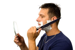 Man is shaving his face with knife Stock Images