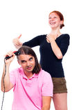 Man shaving his hair and woman laughing at him Royalty Free Stock Image
