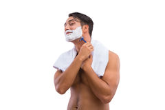 The man shaving isolated on the white background Royalty Free Stock Image