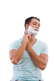 The man shaving isolated on the white background Stock Photo