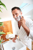 Man shaving with razor Royalty Free Stock Photo