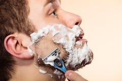 Man shaving with razor Royalty Free Stock Photo