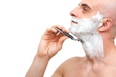 Man shaving with a razorblade Stock Photos