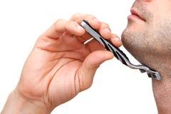 Man shaving with a razorblade royalty free stock photos