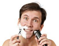 Man shaving with razors Stock Photo