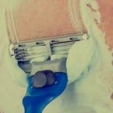 Man shaving using shaving cream or foam Stock Photo