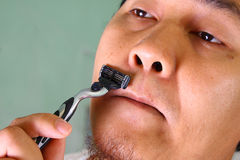 Man Shaving Stock Photo