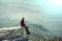 Man on the cliff. Man on the sheer cliff Stock Image