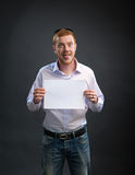 Man with a sheet of paper in his hands Royalty Free Stock Images