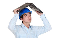 Man sheltering under laptop Stock Photos