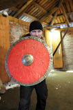 Man with a shield and sword Stock Photography