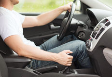 Man shifting the gear on car manual gearbox Royalty Free Stock Photo