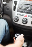 Man shifting the gear on car manual gearbox Stock Image