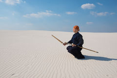 Man with shinai in traditional Japanese clothes took the positio Stock Image