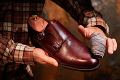 Man shining shoes with a rag. Royalty Free Stock Photos