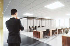 Man in shiny open space office Stock Image